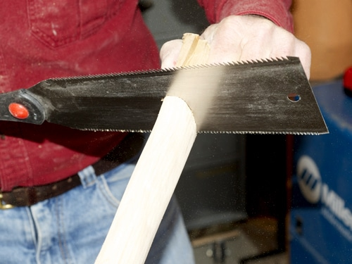 Men Trim the wood handle to length.