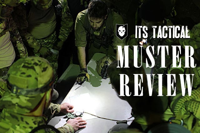 its tactical muster men standing around topo map planning