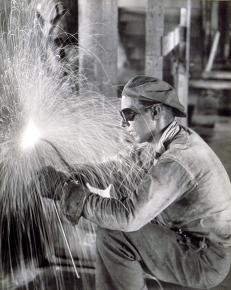 vintage welder working in factory sparks flying