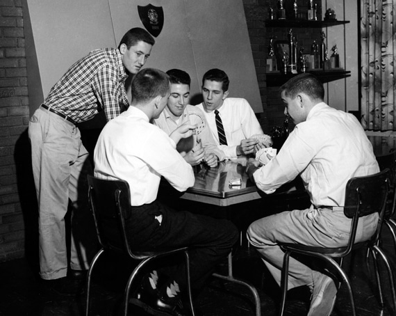 Vintage young college men playing cards.
