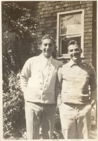 vintage friends posing outside house