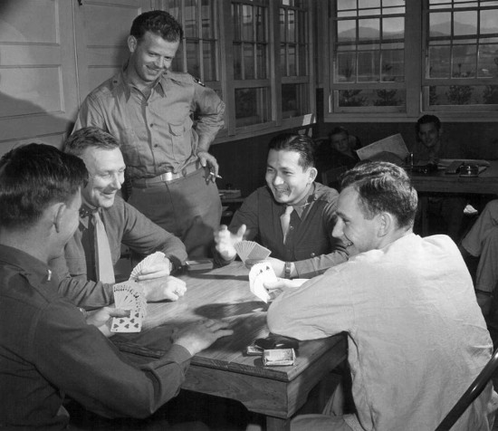 vintage men playing cards laughing smiling