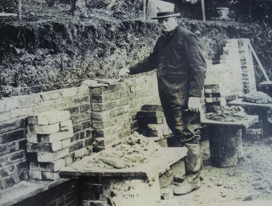 Churchill Standing Near the Brick Wall.