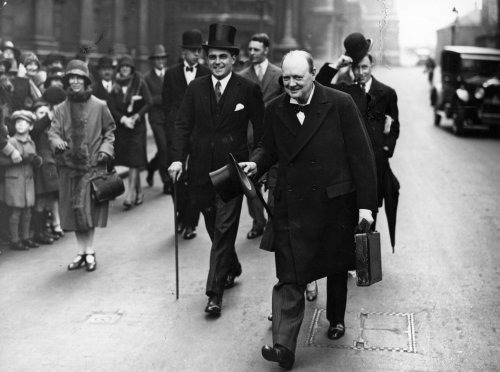 winston churchill walking down street with briefcase