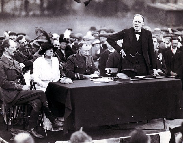 Winston Churchill standing speaking at meeting.