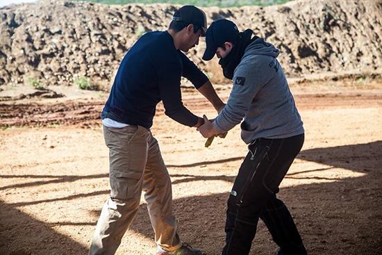 self defense disarming an attacker with gun drawn