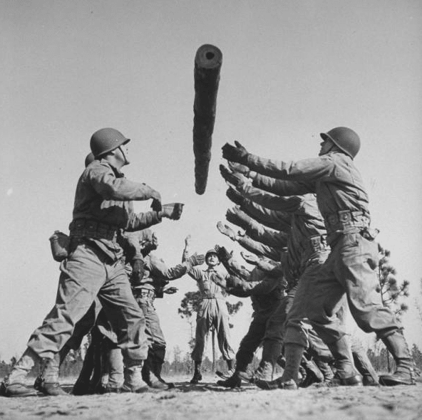 Vintage Soldiers tossing log basic training.