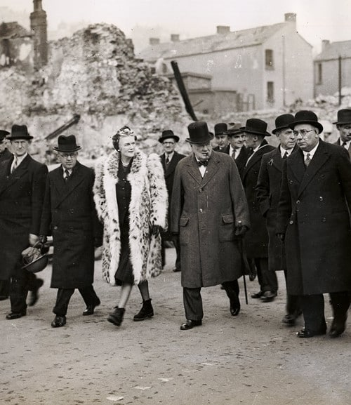 winston and clementine churchill touring war ruin with group of men
