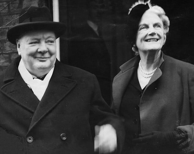 Winston and clementine Churchill outside smiling.