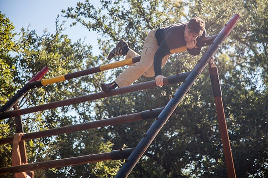 man doing obstacle course atomic athlete vanguard
