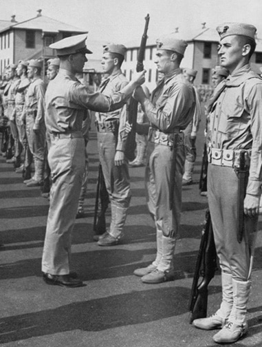 vintage soldiers standing in line at attention sargeant fixing posture