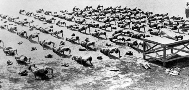 Vintage Soldiers doing push ups in formation.
