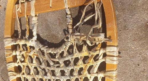 vintage wooden snowshoes in need of repair