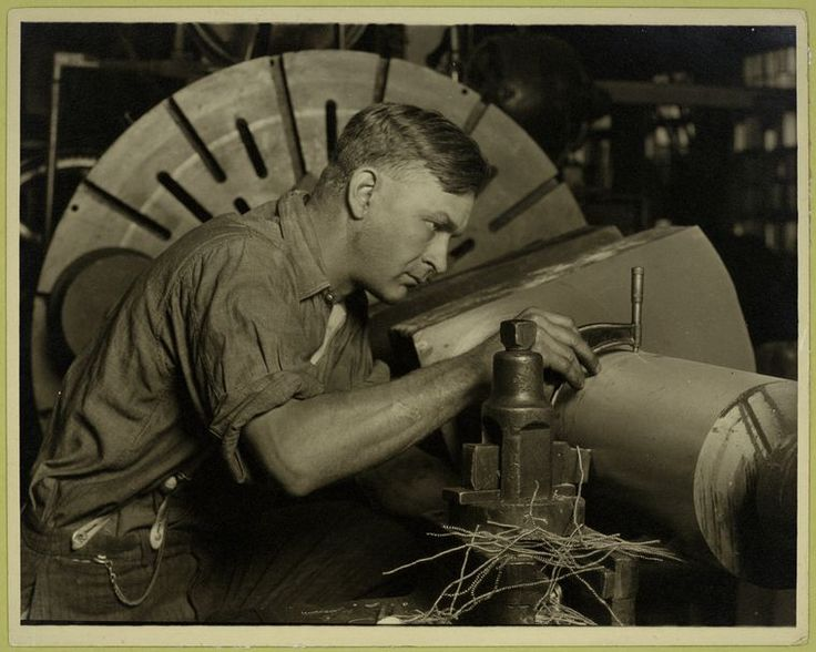 vintage blue collar worker in factory machining