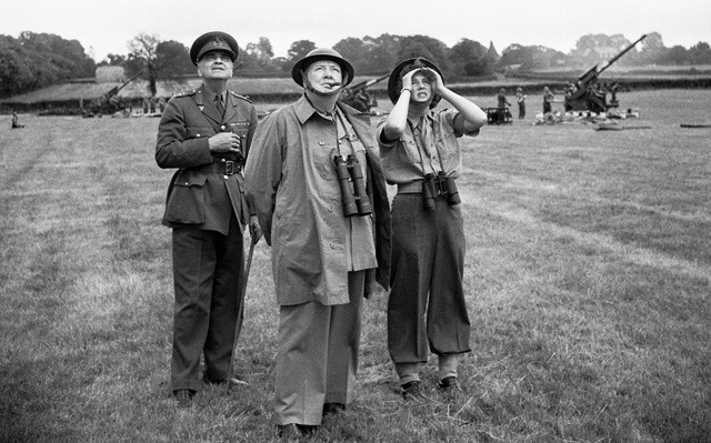 Winston Churchill in field watching Military drills.