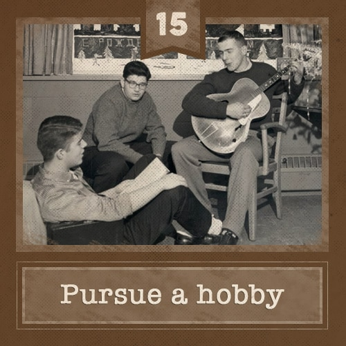 vintage friends men sitting around playing guitar