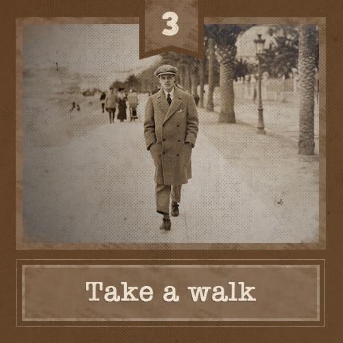 vintage man talking walk on path in winter overcoat