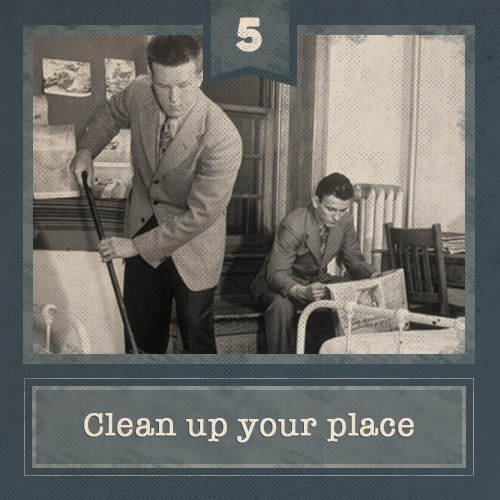 vintage young men cleaning apartment sweeping vacuuming