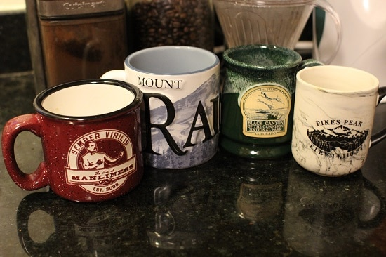 large assorted coffee mugs on kitchen counter