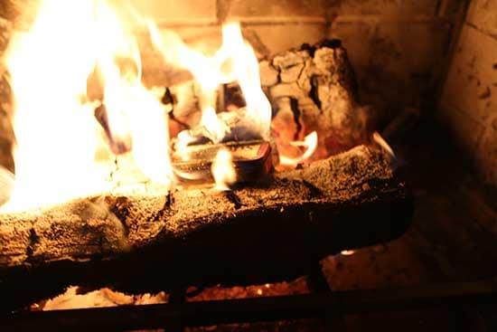 diy homemade char cloth firestarter altoids tin in fireplace