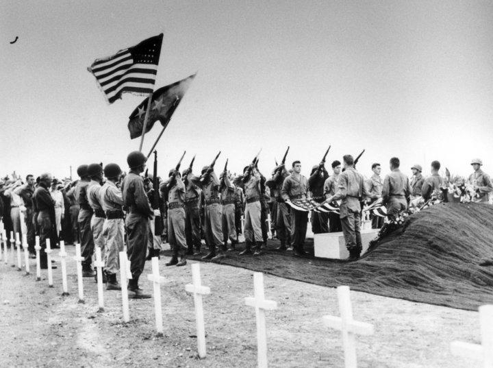 Military funeral 21 gun salute.