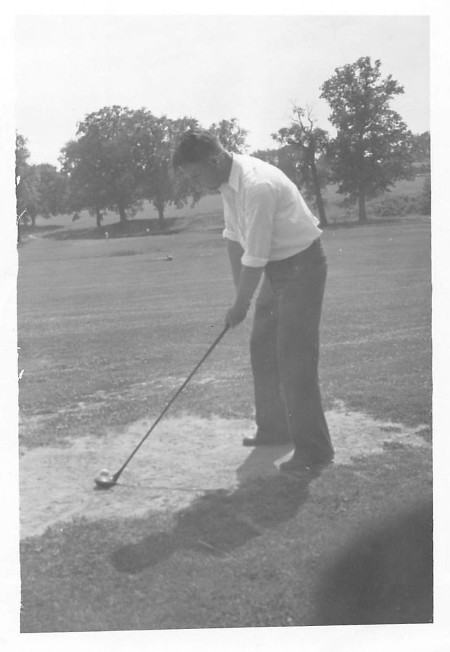 vintage man golfing white polo grainy photo