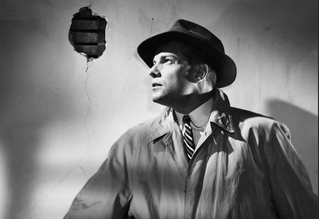 vintage detective wearing trench coat and fedora