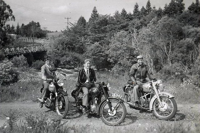 vintage men on motorcycles on trail near river