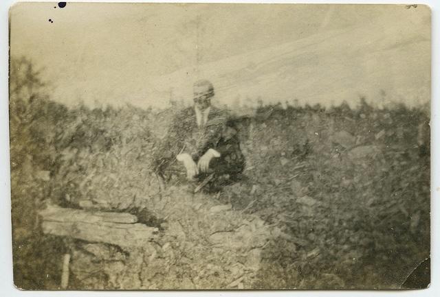 Vintage man sitting in field hazy resolution.