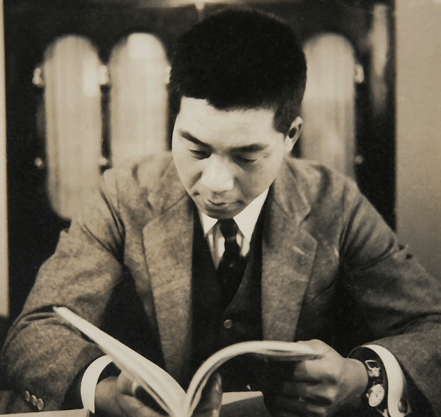 vintage asian man reading book