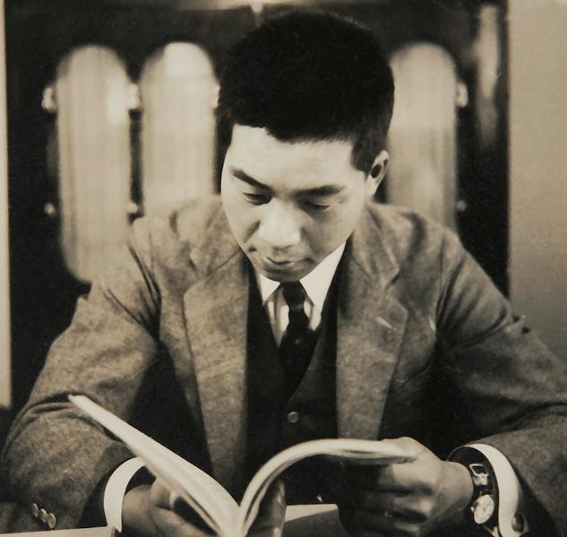 Vintage man reading book.