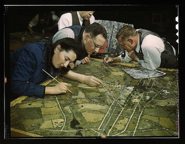 vintage artists working on drawing roadmap