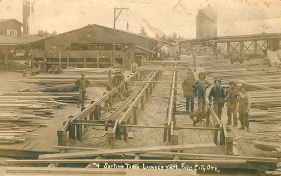 vintage lumberyard men posing for photo