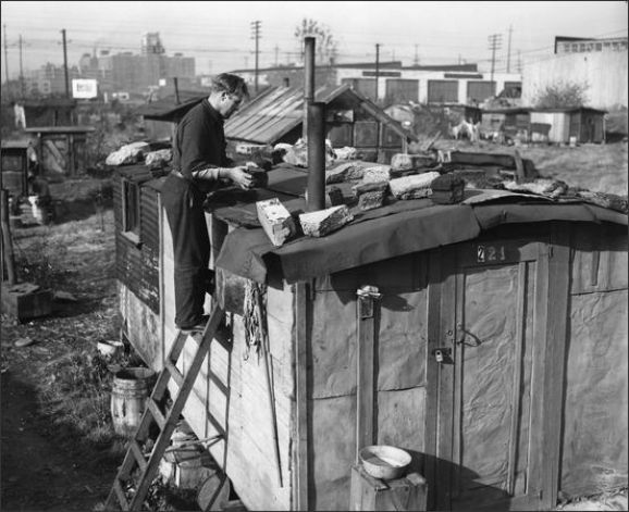 Vintage man on ladder repairing shed roof.