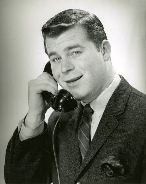 Vintage man on telephone with smiling face.