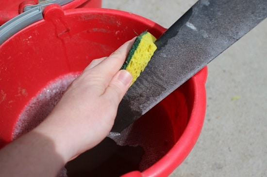 Use your soapy bucket and old sponge to give them a good scrub. That filth should wash right off, and your protectors will look shiny and new.