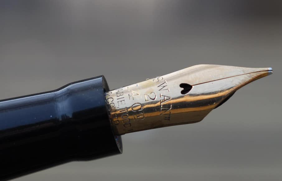 swan fountain pen nib slit and breather hole close up photo