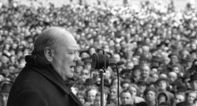 Winston churchill speaking to crowd.