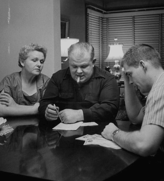 vintage family at dinner table discussing allowance