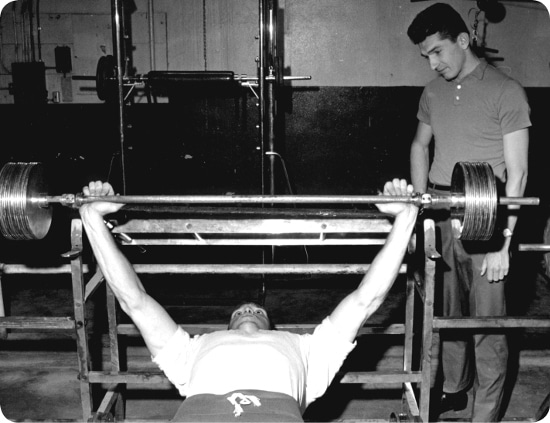 vintage 1950s gym barbell bench press
