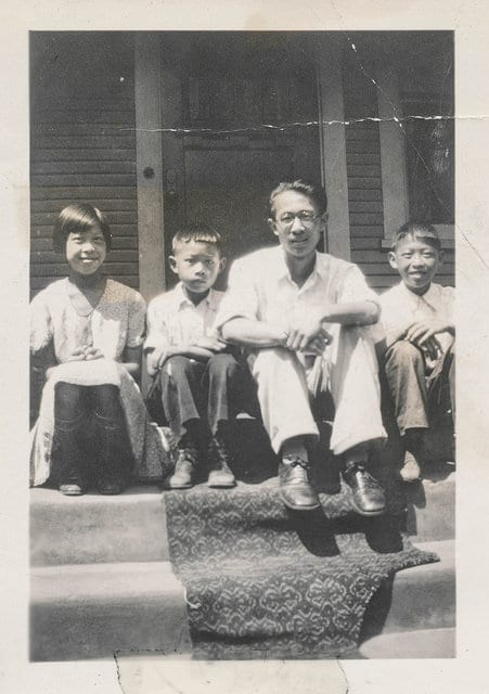 Vintage asian father with children.