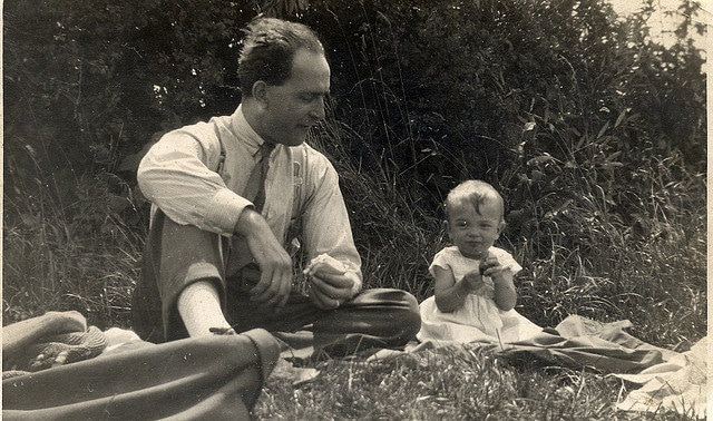 Vintage 1940s father picnic with baby.