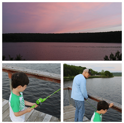 young boy fishing with grandfather on lake