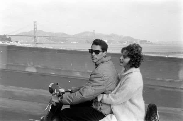 Vintage 1950s couple scooter golden gate bridge.