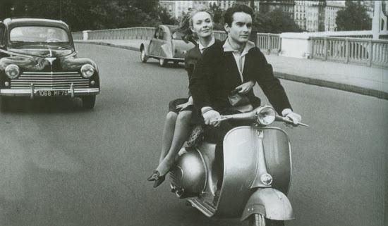 vintage 1960s couple scooter vespa