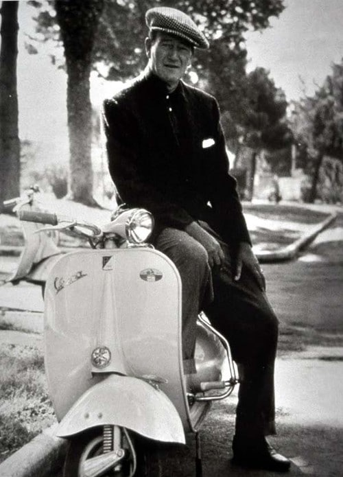 John Wayne vespa scooter.