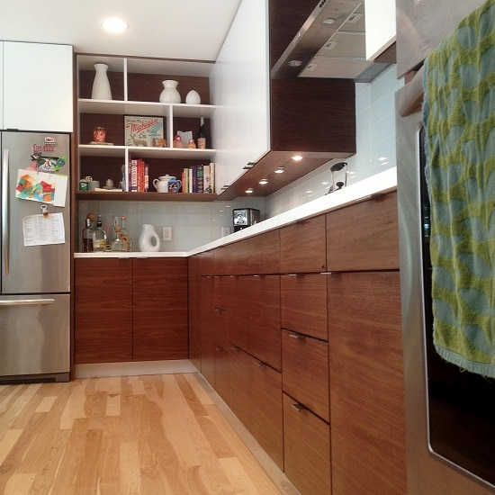 Fully furnished kitchen with wooden floor.