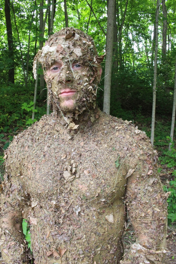 Men covered in stewart forest debris natural camouflage.