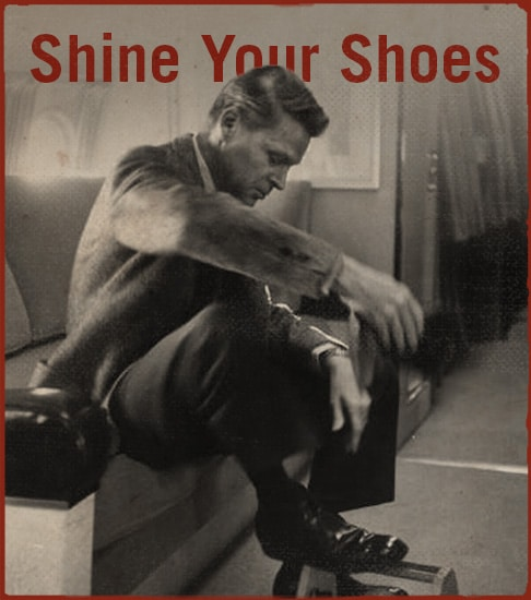 Man is shining his shoes.