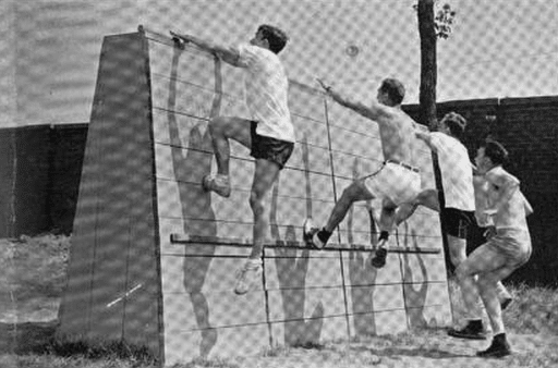University of Michigan students tackle the obstacle course built on Ferry Field during the war.